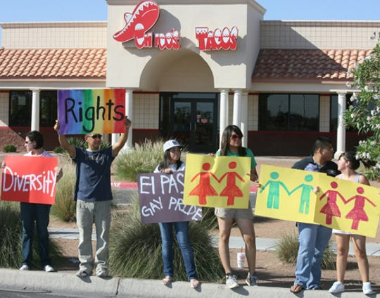 Protesters held up signs and yelled chants about equality in a protest outside the Chico's Tacos restaurant at 11381 Montwood Drive in the summer of 2009.  File art.