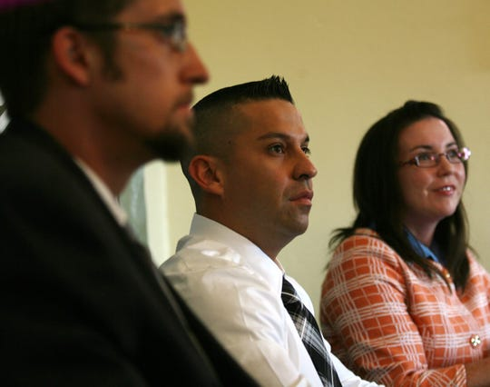 Carlos Diaz De Leon, center, listens to a question during a June 29, 2009, news conference where he, Briana Stone, director of the Paso del Norte Civil Rights Project, and attorney Christopher Benoit talked about a lawsuit brought in response to a June 2009 incident at Chico's Tacos, where five gay men were kicked out after two of them kissed.
