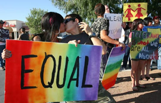 Irma Marquez, 26, and Melissa Mitchell, 29, share a kiss while participating in the protest outside the Chico's Tacos on Montwood Drive in 2009. The protest was a show of support for five gay men that were allegedly kicked out after kissing in the restaurant.
