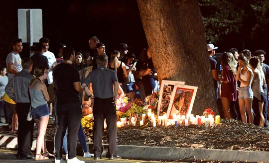 Hundreds attended a candlelight vigil celebrating the life and memory of Dana Kennedy on June 23. The 17-year-old Mt. Whitney student's life was cut tragically short the night before after she crashed into an oak tree in southeast Visalia. Candles and photos surrounded the tree, as dozens of Dana's classmates and loved ones remembered 'the ray of sunshine.'