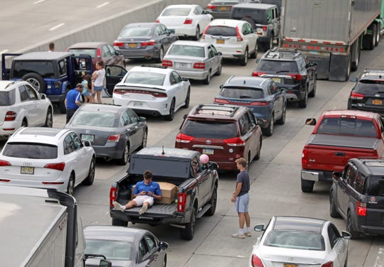 Motorists sit in their car after all lanes are blocked due to a vehicle fire on the Mario M. Cuomo bridge during the evening commute northbound on I-287 in Tarrytown June 24, 2019.