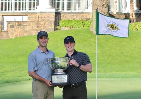 Rick Dowling and Nick Taylor pose with the Wilson Cup after winning by four shots at Scarsdale Golf Club.