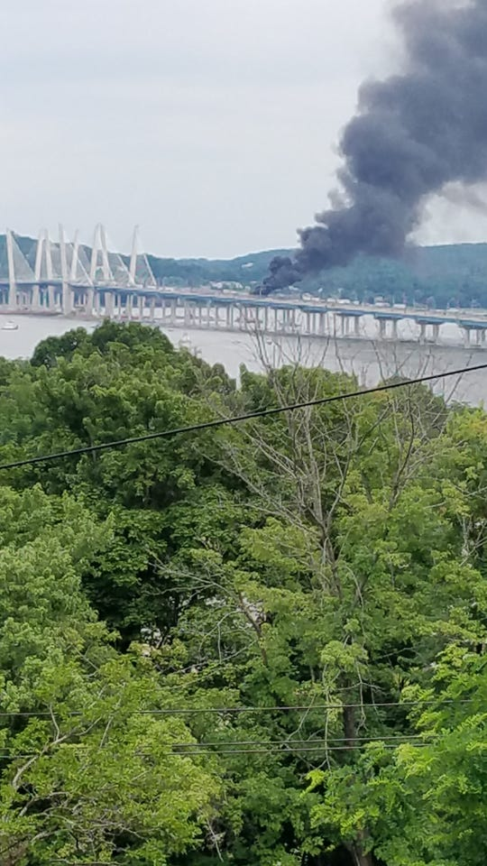 Smoke can be seen from a vehicle fire on the Gov. Mario M. Cuomo Bridge. June 24, 2019.