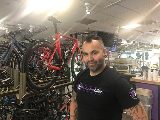 Mattie Davitt, sales manager at Piermont Bike, opened the box containing the stolen bike sent back to the store in Piermont, NY.