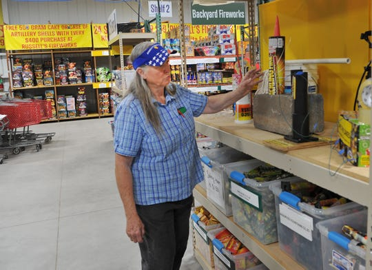 Patsy Hodgkins, owner of Russell's Fireworks points out the store's safety display. Hodgkins said safety is always first when it comes to fireworks.