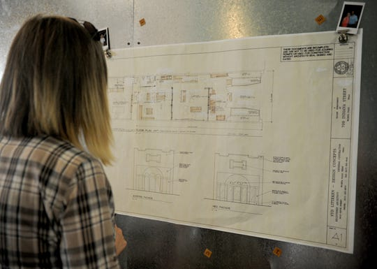 Katie Britt looks over the plans of Downtown Wichita Falls Development, Inc. new office building Monday, June 24, 2019, at 709 Indiana Avenue next to Wichita Falls Brewing Company.