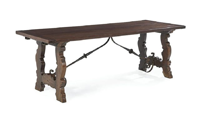 Look for unusual styles of furniture to get a bargain. The heavy, old timbers and craftsmanship of an antique is why it is still in good condition and can take hard use. This table is in the Elizabethan style, 400 years old, and still going strong.