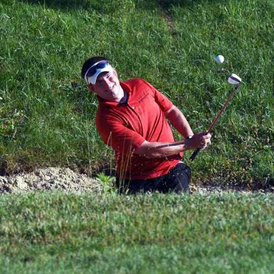 J.J. Mickey chips from the greenside bunker on the 18th hole during the second round of the 2019 Zanesville District Golf Association Amateur tournament at EagleSticks. Mickey eventually won the tournament.