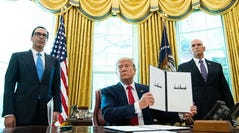epa07670867 US President Donald J. Trump holds up a copy of an executive order for additional sanctions against Iran and its leadership, after signing it in the Oval Office at the White House in Washington, DC, USA, on 24 June 2019, as US Secretary of the Treasury Steven Mnuchin (L) and US Vice President Mike Pence (R) look on. The sanctions come in the wake of rising tensions in the Middle East including Iran's recent shooting down of a US drone.  EPA-EFE/KEVIN DIETSCH / POOL ORG XMIT: WAP20190624304