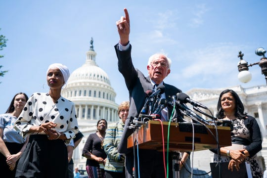 From left, Rep. Ilhan Omar, Sen. Bernie Sanders and Rep. Pramila Jayapal introduce the student loan plan on June 24, 2019.