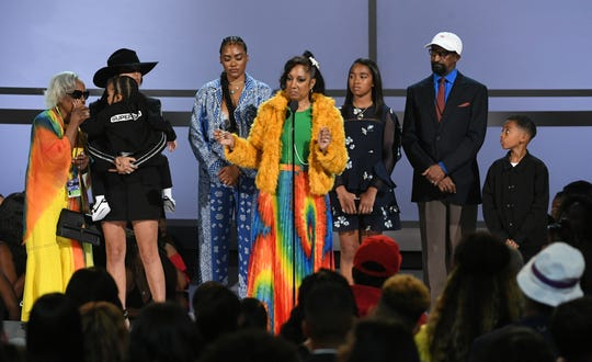 Nipsey Hussle's family, including fiancee Lauren London, accept the Humanitarian Award in honor of the slain rapper at the 2019 BET Awards.