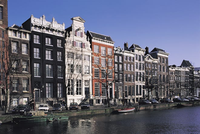 Canal house architecture seen in Amsterdam.