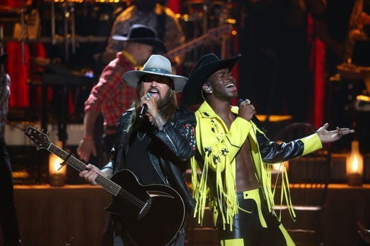 Billy Ray Cyrus (L) and Lil Nas X perform onstage during the 2019 BET awards at Microsoft Theater in Los Angeles, California on June 23, 2019. (Photo by Jean-Baptiste LACROIX / AFP)JEAN-BAPTISTE LACROIX/AFP/Getty Images ORIG FILE ID: AFP_1HS427