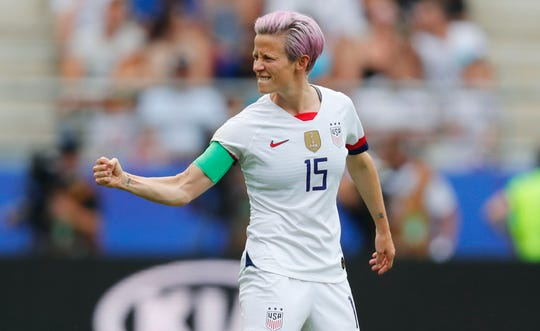 Megan Rapinoe celebrates after scoring on a penalty kick during the first half of a World Cup match against Spain.