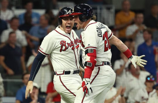 Freddie Freeman and Josh Donaldson celebrate a home run.