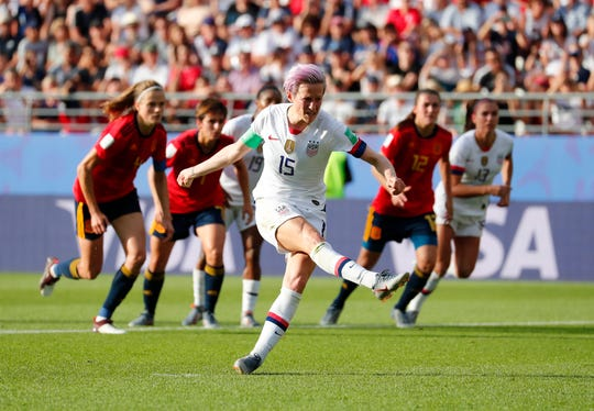 United States forward Megan Rapinoe (15) scores a penalty kick goal against Spain during the second half in a round of 16 match of the World Cup.