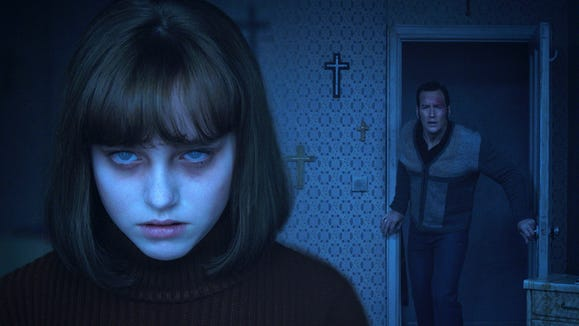"""Ed Warren (Patrick Wilson, right) tries to helped the possessed Janet (Madison Wolfe) in """"The Conjuring 2."""""""