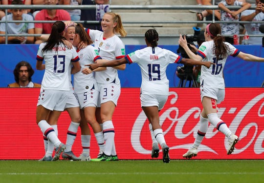 United States forward Megan Rapinoe celebrates with teammates after scoring a penalty kick goal against Spain during their Round of 16 match at the Women's World Cup.