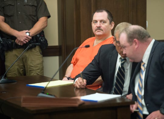 """In this June 19, 2018 file photo, Aubrey Trail, left, looks on during a hearing in Saline County Court, in Wilbur, Neb. Trail, on trial for the 2017 slaying of a Lincoln woman has slashed his neck and fallen from a wheelchair during court proceedings Monday, June 24, 2019. Aubrey Trail yelled """"Bailey is innocent, and I curse you all"""" before swiping what may have been a pen across his neck."""