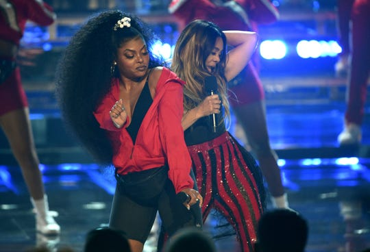 Taraji P. Henson, left, and host Regina Hall rock their D.C. roots at the start of the BET Awards.