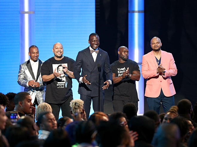 """Korey Wise, left, Raymond Santana Jr., Yusef Salaam, Antron McCray and Kevin Richardson, wrongly convicted of an infamous 1989 rape in New York's Central Park, received the warmest of receptions when they were introduced as """"the Exonerated Five"""" at the BET Awards in Los Angeles on Sunday."""