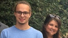 Jen Thompson poses with her son, Nathan, outside his dorm at Michigan State University.