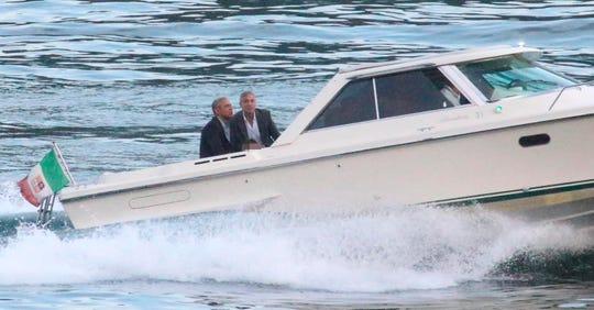 Former President Barack Obama, left, and George Clooney on a boat June 23, 2019.
