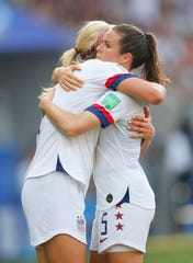 Americans Lindsey Horan, left, and Kelley O'Hara celebrating after defeating Spain on Monday.