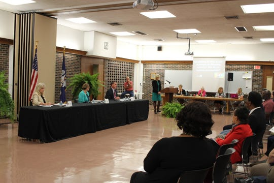 The three finalists for the Rapides Parish schools superintendent position - (from left at table) Kimberly Bennett, Deborah Heitman and Jeff Powell - met the public and answered questions Monday evening. Rapides Parish School Board members will vote Thursday to name a new superintendent.