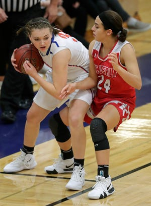 Appleton West's Christy Fortune, left, protects the ball against Kimberly's Shea Dechant during a game last season in Appleton. Fortune recently committed to play in college at McKendree University.