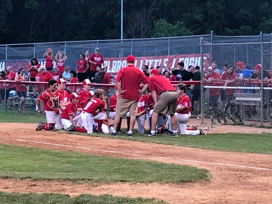 The Holbrook Little League team has its postgame chat after winning 5-4 over Brick on June 24, 2019 in Jackson, N.J.