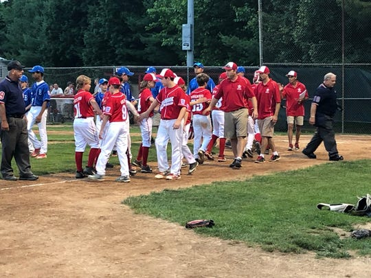 The Holbrook 12-year-old All-Stars shake hands with Brick after the conclusion of the 5-4 win for Holbrook.