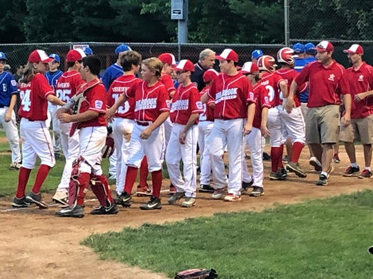 The Holbrook 12-year-old All-Stars shake hands with Brick after the conclusion of the 5-4 win for Holbrook