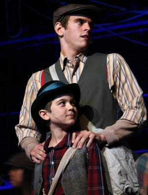 """Davey (James Melson, top) and Les (Phoenix Lowe) are new to the newsies game but become instrumental in plans for a strike in this rehearsal scene from """"Newsies,"""" which opens Friday at the Paramount Theatre. June 24 2019"""