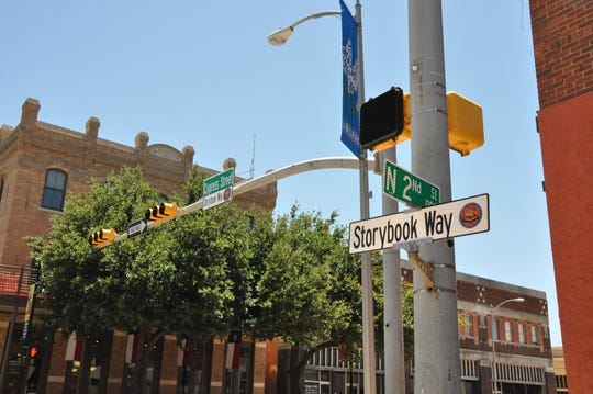 New honorary Storybook Way street signs were installed Tuesday on Cypress Street in downtown Abilene.
