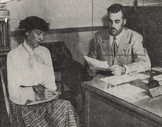W. Willis Cox Jr. sports a beard that would be fashionable in 2019 while at work at Cox Hunter Hall Insurance in 1949. Chief underwriter at the time, he is working with secretary Ann Canada.