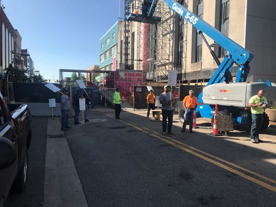 Workers for RAM Construction go on strike outside The Milton over a contract dispute.