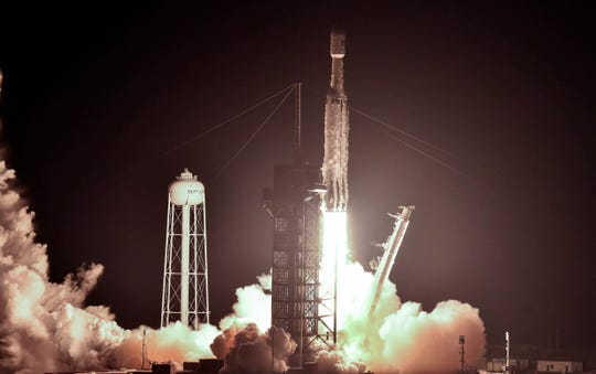 Pictures of SpaceX Falcon Heavy rocket launch at Kennedy