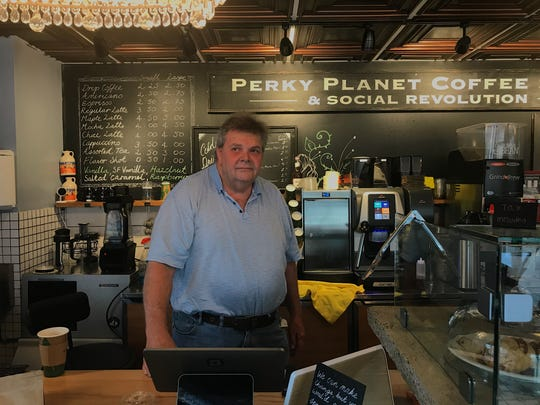 Richard Vaughn, owner of Perky Planet Coffee (& Social Revolution) on Tuesday, June 25 opens for the day despite the St. Paul St. and King Street construction, which has been extended until September.