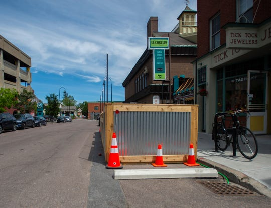 Each of the Street Seats like this one in front of El Cortijo on Bank Street in Burlington, VT, June 25, 2019, takes up between 1 or 2 parking spaces and is level with the sidewalk.