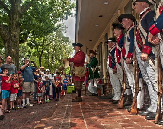 File Bob DeMinico reads the Declaration of Independence to a crowd outside Indian King Tavern in Haddonfield on July 4 in 2015. The reading by a 'town crier' precedes Haddonfield's Fourth of July parade each year.
