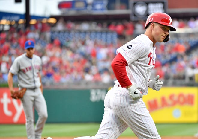 Jun 24, 2019; Philadelphia, PA, USA; Philadelphia Phillies left fielder Rhys Hoskins (17) looks into the dugout after hitting a home run during the first inning against the New York Mets at Citizens Bank Park. Mandatory Credit: Eric Hartline-USA TODAY Sports