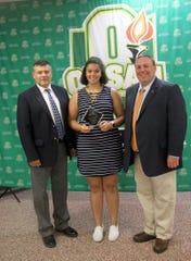 Chillicothe High School graduate Meliah Johnson poses with SEDAB rep Mark Rose and OHSAA rep Jeff Jordan after receiving the the OHSAA Ethnic Minority Scholarship. In conjunction with the Ohio High School Athletic Association, the Southeast District Athletic Board hosted its annual Scholar-Athlete Banquet on Monday, June 24, 2019 in Jackson.