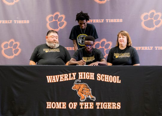 Surrounded by his parents Tim and Angie Remington and brother Luke, Waverly senior Cody Remington signed his letter of intent for collegiate track at West Liberty University at Waverly High School on June 25, 2019.