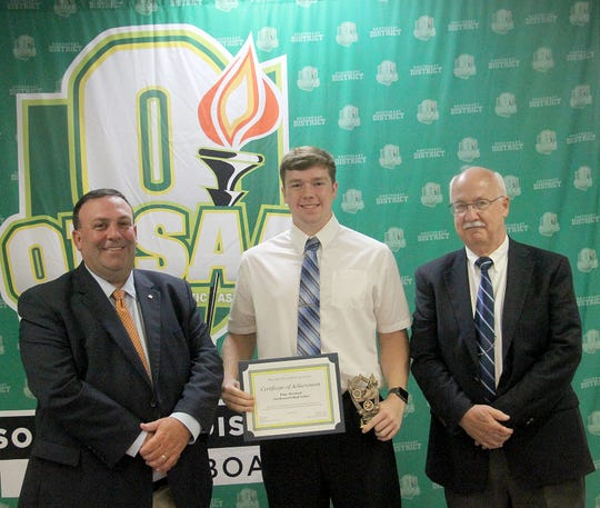 Southeastern High School graduate Elias Dresbach poses with OHSAA Jeff Jordan and SEDAB rep Leonard Steyer after receiving the SEDAB scholarship. In conjunction with the Ohio High School Athletic Association, the Southeast District Athletic Board hosted its annual Scholar-Athlete Banquet on Monday, June 24, 2019 in Jackson.