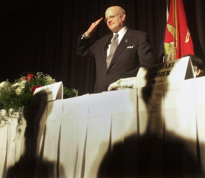 Text: 2001.02.09.08.01 CHAMBER METRO NIKON DIGITAL IMAGE : John Williams, retiring president of The Greater Cincinnati Chamber of Commerce salutes The Marine Corp Color Guard after a precentation in his honor at the Chamber's annual meeting in Feburary 2001.