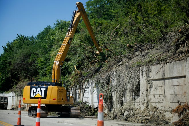Crews continue work to clean up and prevent future landslides along Columbia Parkway near Kemper Lane in the East End neighborhood of Cincinnati June 25.