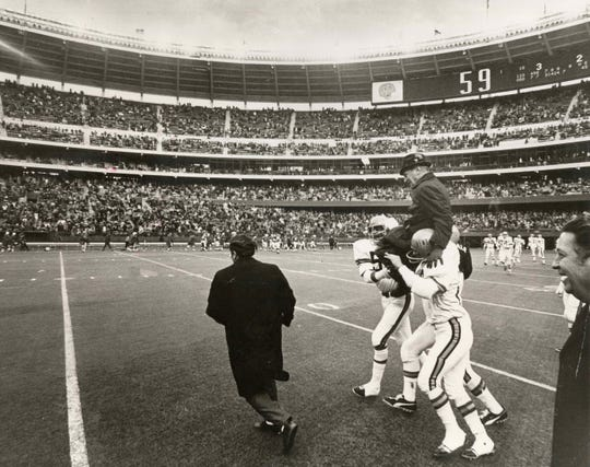 DECEMBER 20, 1970: Proud players carried Paul Brown off the field after the last game at Riverfront Stadium when the Bengals beat the Boston Patriots for the AFL Central title.