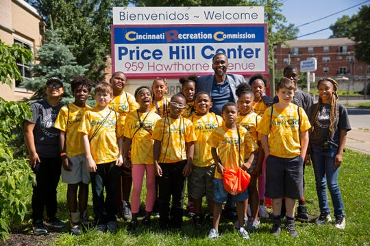 Daniel Betts, the recreation department director, makes a surprise visit to the Price Hill Recreation Center before their field trip to the zoo. The center doles out the shirts and backpacks prior to the trip and collects them at the end of the day so they can be washed. The center offers special activities each day, with weekly field trips.