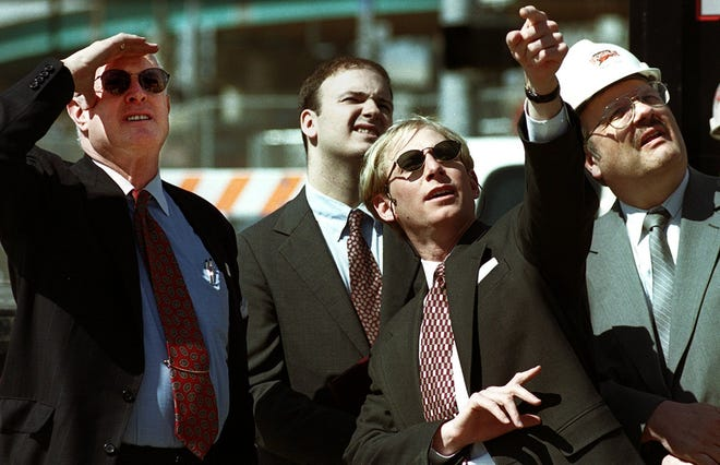 John Williams, then with the Chamber of Commerce, shown in 2000 with Jeff Berding, then Director of Community Affairs for the Cincinnati Bengals, Hamilton County Commissioner Tom Neyer and Hamilton County Administrator David Krings as the final beam is lowered into place at the topping out of Paul Brown Stadium.